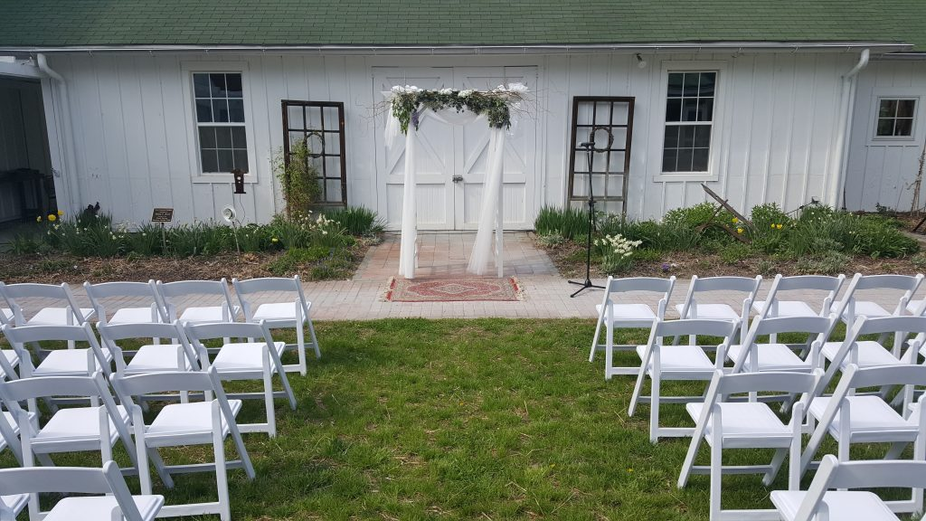 The courtyard is beautifully set for an outdoor wedding