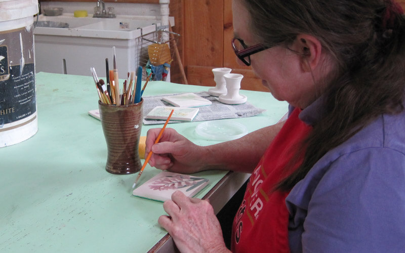 Artist Jean Fletcher at work in her studio