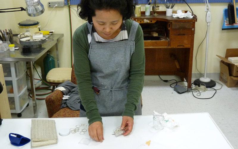 image of EunJu Lee, Silversmith at work