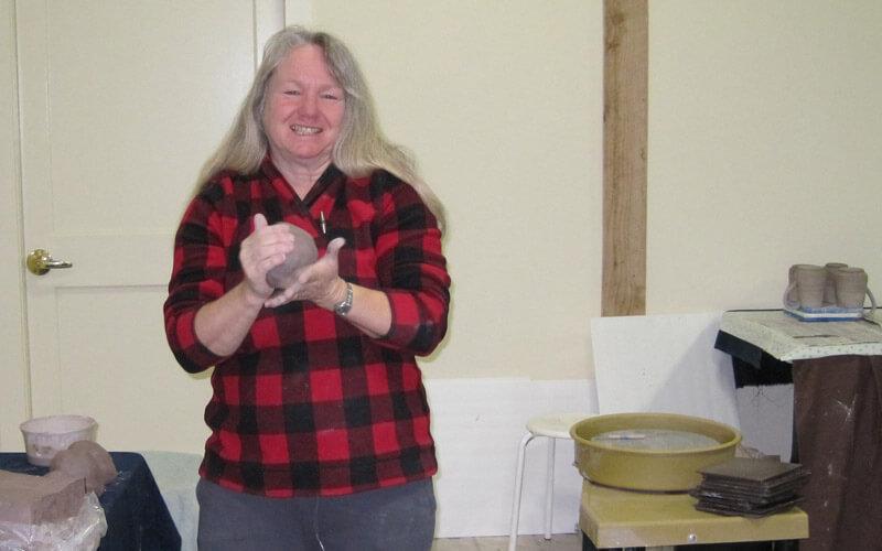 Artist Pamela Reid in her pottery studio