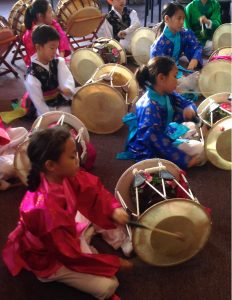 young children playing drums