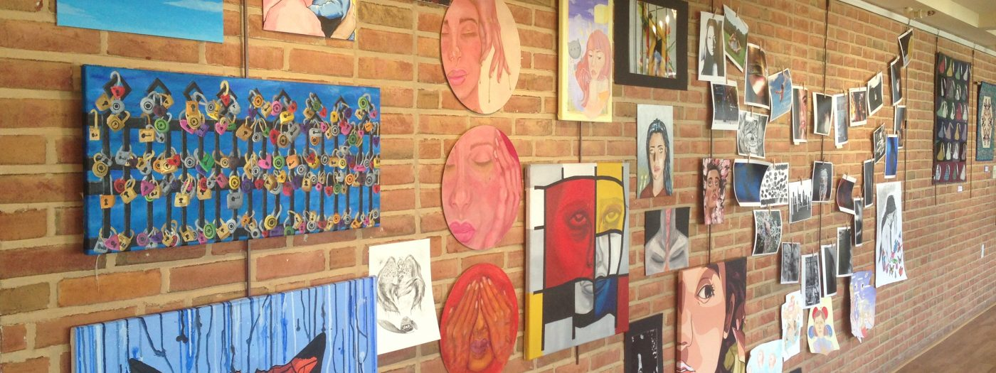 wall covered in various local art pieces