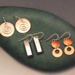 mixed metal earrings on display