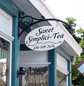 A store front with Sweet Simplici-Tea sign