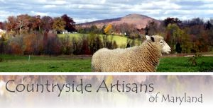 sheep in field with Countryside Artisans of Maryland text overlay