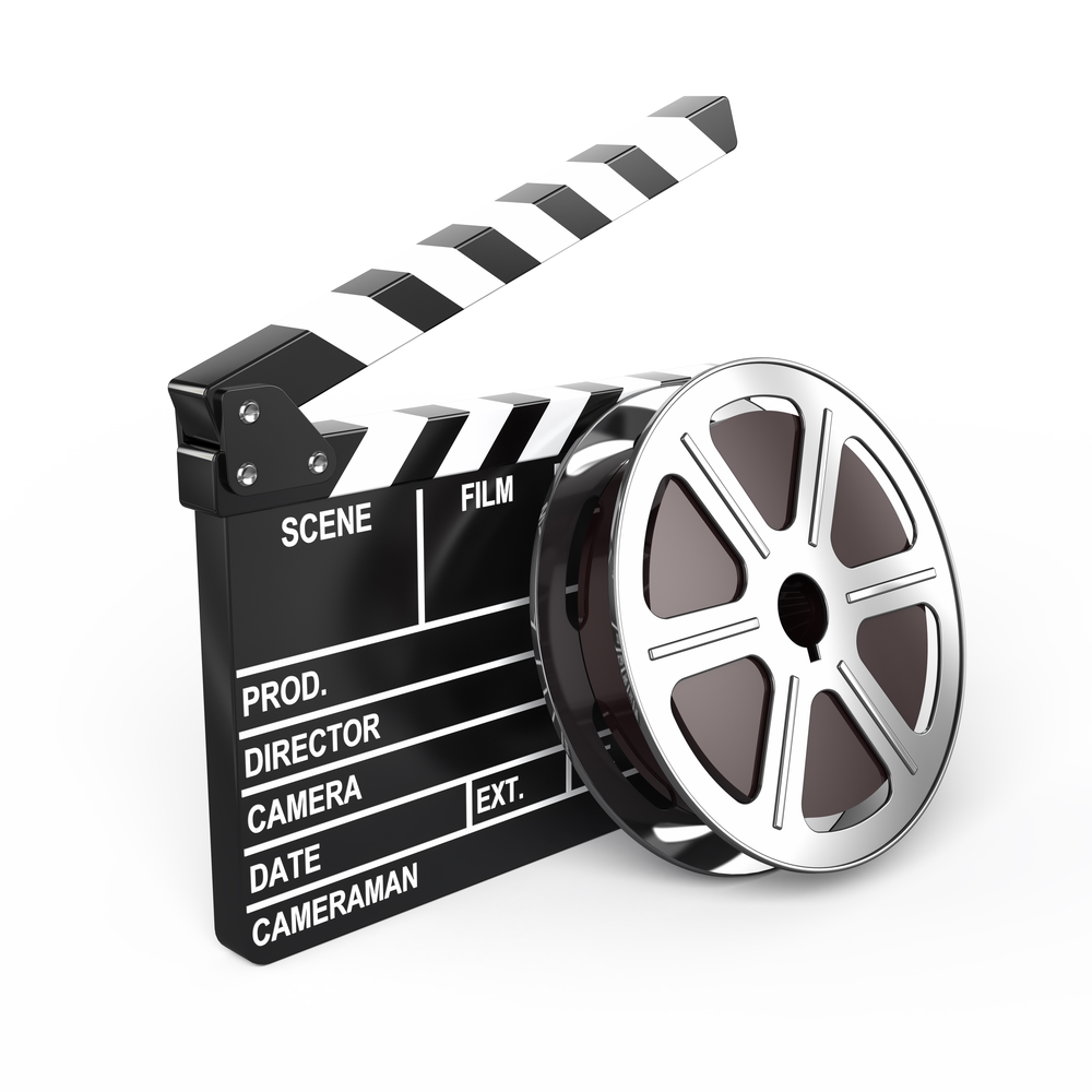 film reel propped up against a clapperboard