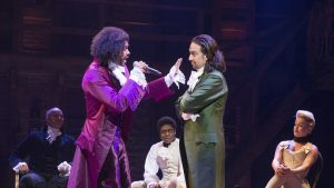Actors from Hamilton the musical on stage performing