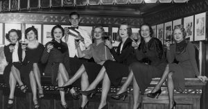 Women toasting with cocktails during prohibition.