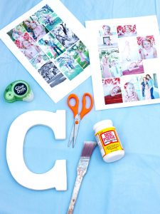 craft materials to make a collage on a large letter