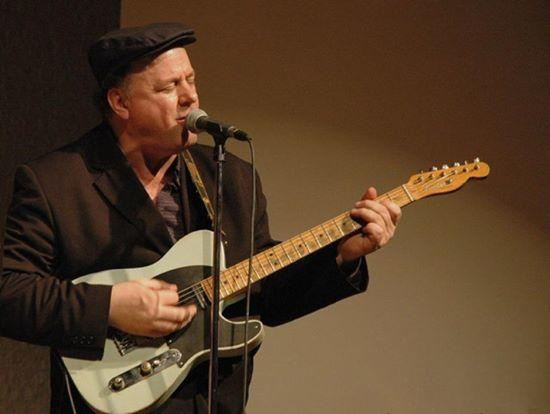 Jazz musician Dave Chappell singing and playing guitar