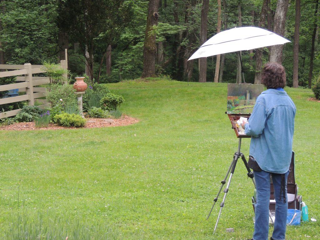 Plein Air artist painting a garden