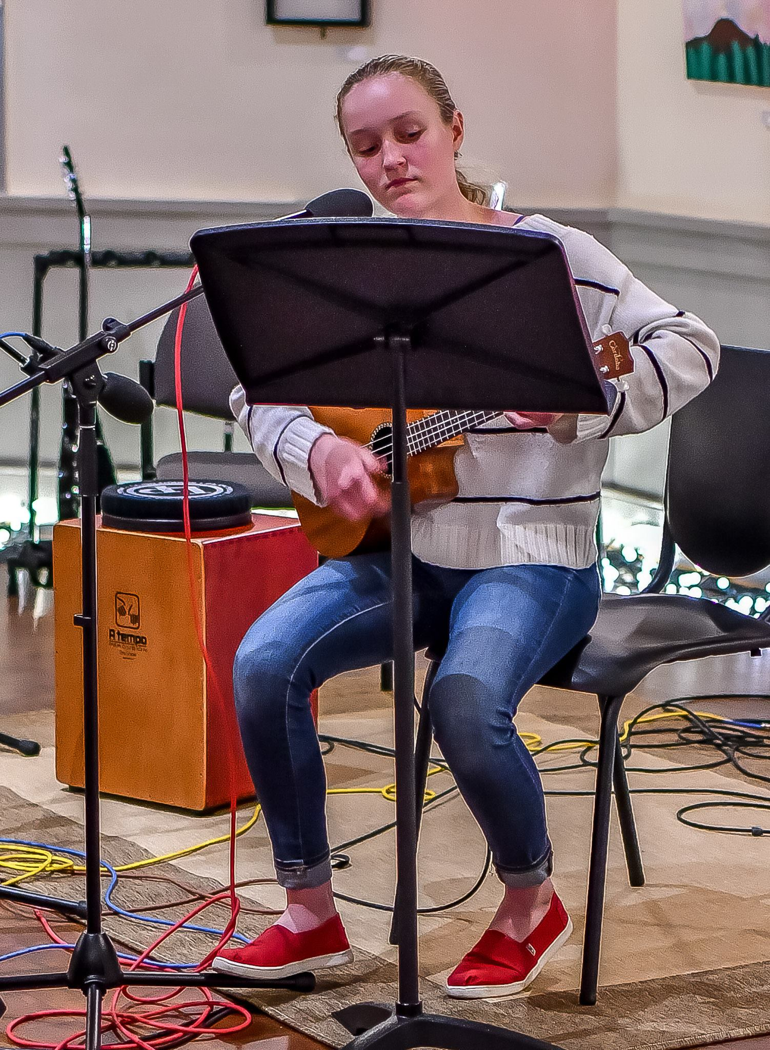 Teenage girl performing at Community Open Mic Night in January 2019