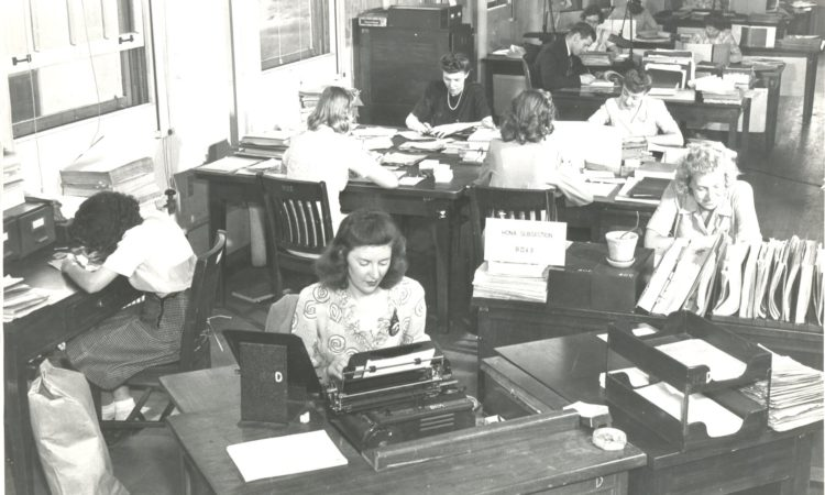 Ann Caracristi, along with several other women, at Alrington Hall working on breaking codes.