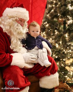 Santa sitting with baby on his lap