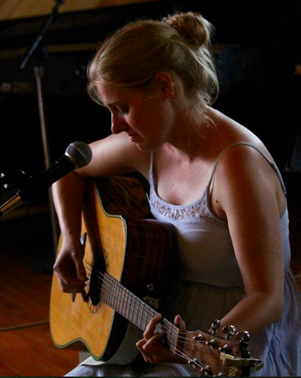 Adele McAllister playing guitar